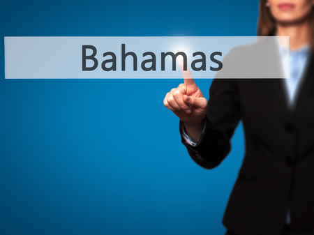 bahamian: Bahamas - Businesswoman hand pressing button on touch screen interface. Business, technology, internet concept. Stock Photo Stock Photo