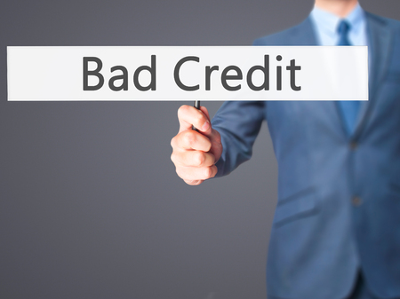 customer records: Bad Credit - Business man showing sign. Business, technology, internet concept. Stock Photo