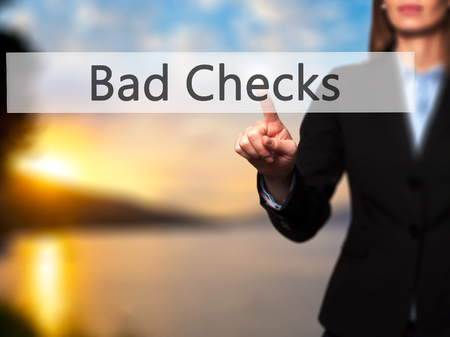 checks: Bad Checks - Businesswoman hand pressing button on touch screen interface. Business, technology, internet concept. Stock Photo Stock Photo