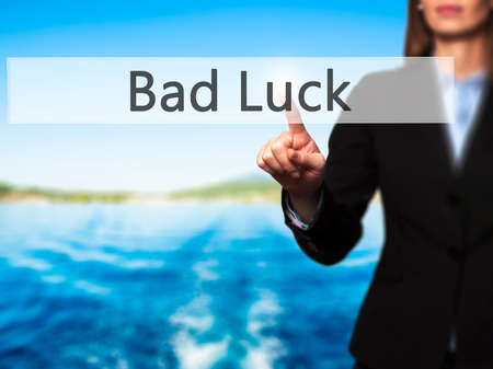 bad fortune: Bad Luck - Businesswoman hand pressing button on touch screen interface. Business, technology, internet concept. Stock Photo