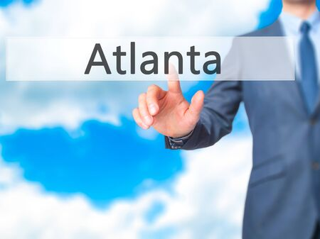 atlanta tourism: Atlanta - Businessman hand pressing button on touch screen interface. Business, technology, internet concept. Stock Photo Stock Photo