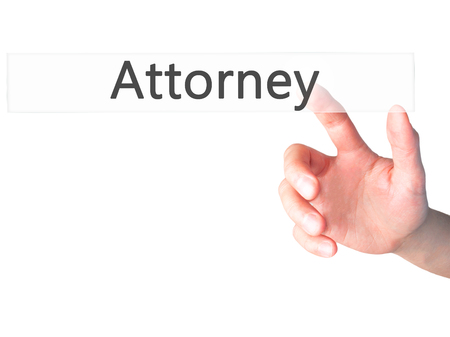 mandate: Attorney - Hand pressing a button on blurred background concept . Business, technology, internet concept. Stock Photo
