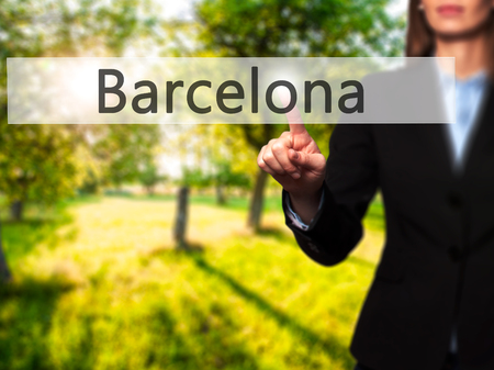 Barcelona -  Female touching virtual button. Business, internet concept. Stock Photo