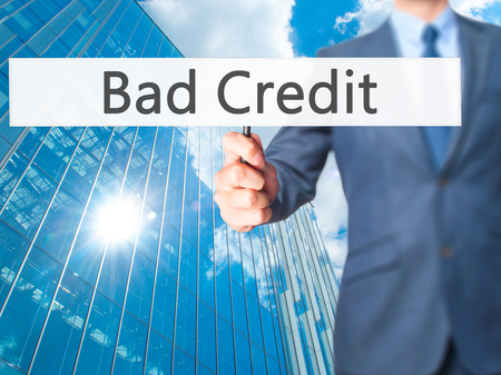budget repair: Bad Credit - Business man showing sign. Business, technology, internet concept. Stock Photo