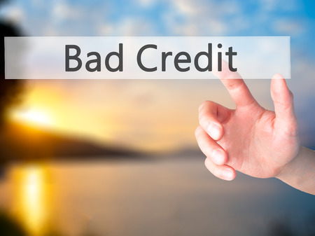 budget repair: Bad Credit - Hand pressing a button on blurred background concept . Business, technology, internet concept. Stock Photo