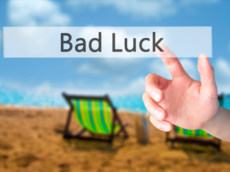 Bad Luck - Hand pressing a button on blurred background concept . Business, technology, internet concept. Stock Photo