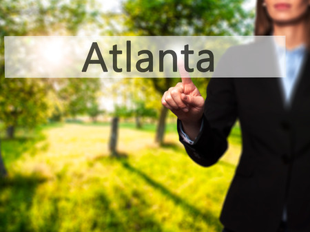 american midwest: Atlanta - Businesswoman hand pressing button on touch screen interface. Business, technology, internet concept. Stock Photo