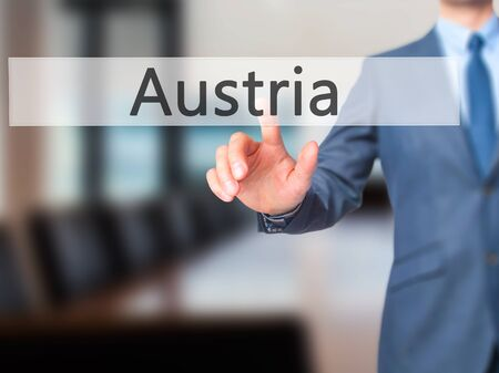 Austria - Businessman hand pressing button on touch screen interface. Business, technology, internet concept. Stock Photo Stock Photo