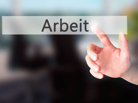 arbeit: Arbeit (Work in German) - Hand pressing a button on blurred background concept . Business, technology, internet concept. Stock Photo Stock Photo