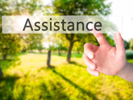 executive assistants: Assistance - Hand pressing a button on blurred background concept . Business, technology, internet concept. Stock Photo Stock Photo