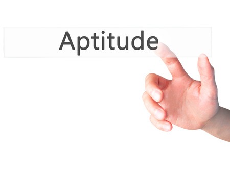 aptitude: Aptitude - Hand pressing a button on blurred background concept . Business, technology, internet concept. Stock Photo