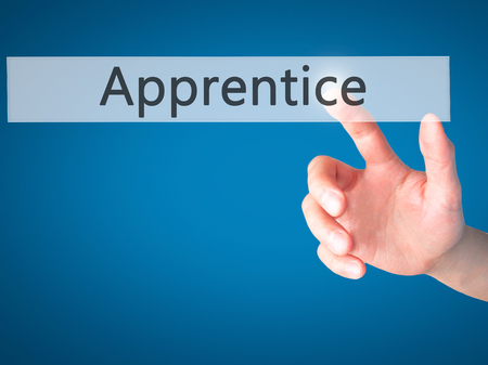 apprenticeship employee: Apprentice - Hand pressing a button on blurred background concept . Business, technology, internet concept. Stock Photo Stock Photo