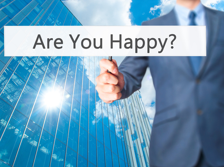 happines: Are You Happy ? - Business man showing sign. Business, technology, internet concept. Stock Photo Stock Photo