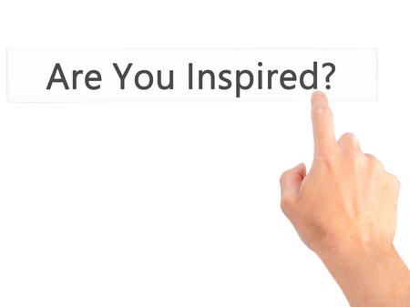 inspired: Are You Inspired ? - Hand pressing a button on blurred background concept . Business, technology, internet concept. Stock Photo
