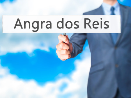 accommodating: Angra dos Reis - Business man showing sign. Business, technology, internet concept. Stock Photo