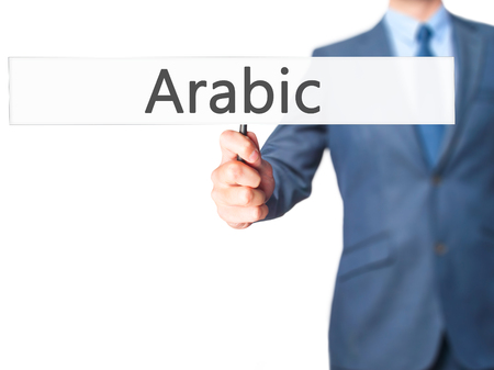 theology: Arabic - Business man showing sign. Business, technology, internet concept. Stock Photo Stock Photo