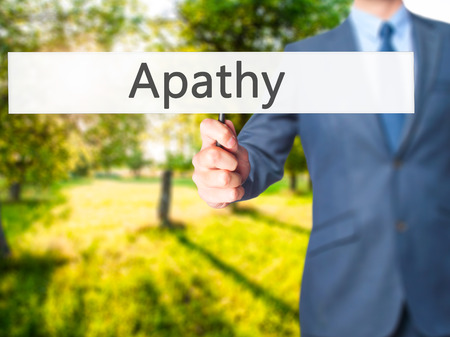 apathy: Apathy - Business man showing sign. Business, technology, internet concept. Stock Photo