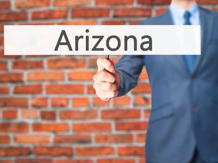 Arizona - Business man showing sign. Business, technology, internet concept. Stock Photo Stock Photo