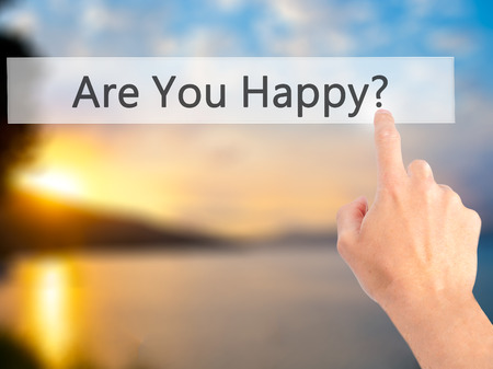 happines: Are You Happy ? - Hand pressing a button on blurred background concept . Business, technology, internet concept. Stock Photo Stock Photo