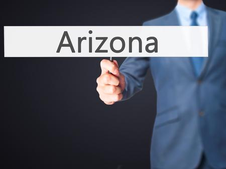 stone of destiny: Arizona - Business man showing sign. Business, technology, internet concept. Stock Photo Stock Photo