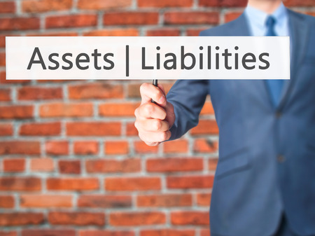 cashflow: Assets Liabilities - Business man showing sign. Business, technology, internet concept. Stock Photo Stock Photo