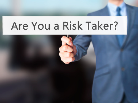 taker: Are You a Risk Taker ? - Business man showing sign. Business, technology, internet concept. Stock Photo Stock Photo