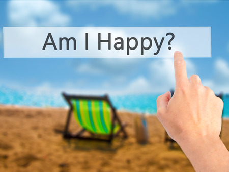 Am I Happy ? - Hand pressing a button on blurred background concept . Business, technology, internet concept. Stock Photo