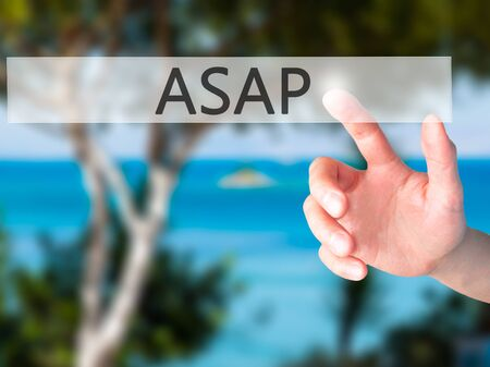the requirement: ASAP - Hand pressing a button on blurred background concept . Business, technology, internet concept. Stock Photo