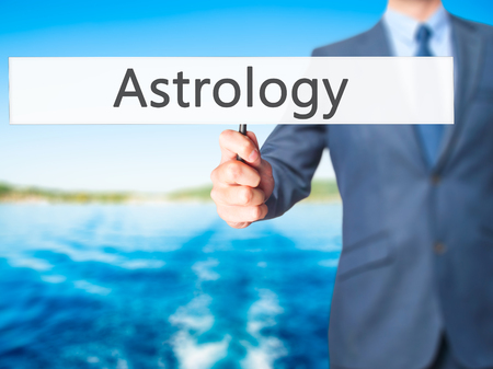 conjunction: Astrology - Business man showing sign. Business, technology, internet concept. Stock Photo