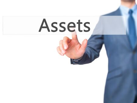 digital asset management: Assets - Businessman press on digital screen. Business,  internet concept. Stock Photo