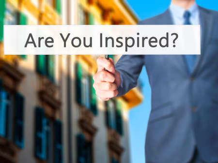 inspired: Are You Inspired ? - Business man showing sign. Business, technology, internet concept. Stock Photo
