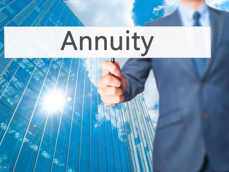 Annuity - Business man showing sign. Business, technology, internet concept. Stock Photo