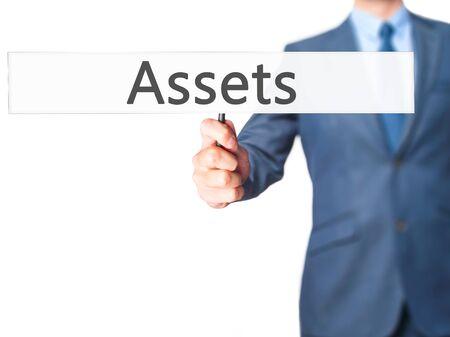 digital asset management: Assets - Business man showing sign. Business, technology, internet concept. Stock Photo Stock Photo