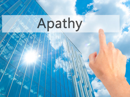 Apathy - Hand pressing a button on blurred background concept . Business, technology, internet concept. Stock Photo