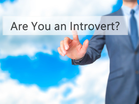 extrovert: Are You an Introvert ? - Businessman press on digital screen. Business,  internet concept. Stock Photo Stock Photo