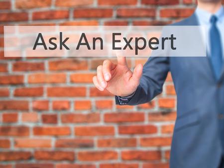 Ask An Expert - Businessman press on digital screen. Business,  internet concept. Stock Photo Stock Photo