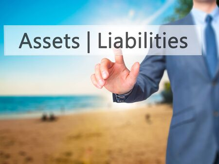cash flow statement: Assets Liabilities - Businessman press on digital screen. Business,  internet concept. Stock Photo Stock Photo