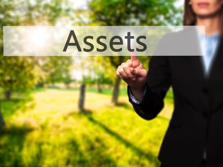 personal perspective: Assets - Isolated female hand touching or pointing to button. Business and future technology concept. Stock Photo