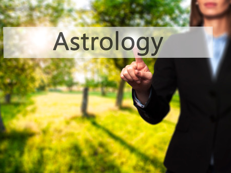 Astrology - Isolated female hand touching or pointing to button. Business and future technology concept. Stock Photo