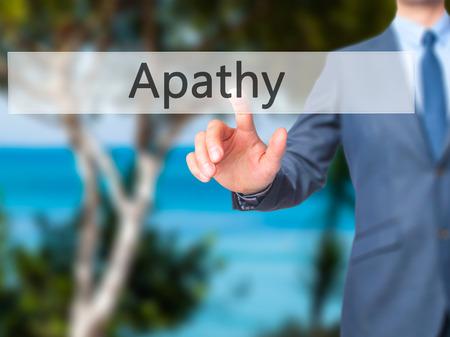 Apathy - Businessman press on digital screen. Business,  internet concept. Stock Photo