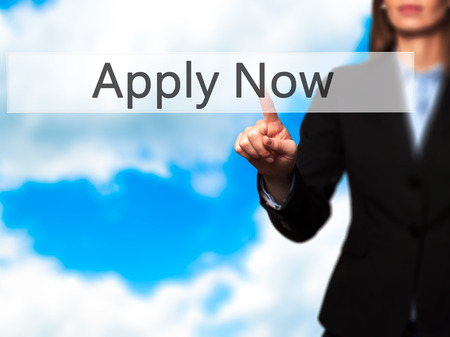application university: Apply Now - Isolated female hand touching or pointing to button. Business and future technology concept. Stock Photo