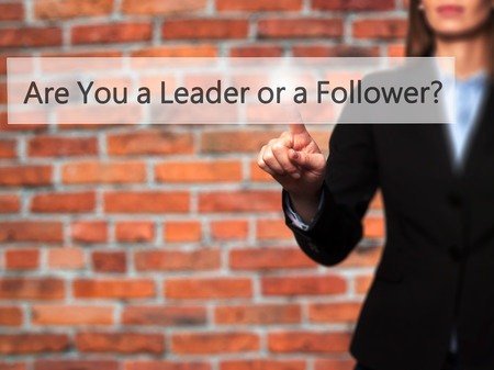 submissive: Are You a Leader or a Follower ? - Isolated female hand touching or pointing to button. Business and future technology concept. Stock Photo