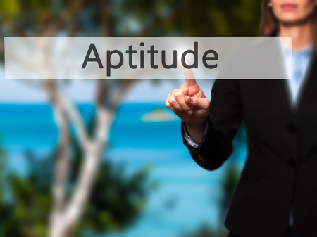 aptitude: Aptitude - Isolated female hand touching or pointing to button. Business and future technology concept. Stock Photo