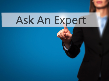 Ask An Expert - Isolated female hand touching or pointing to button. Business and future technology concept. Stock Photo