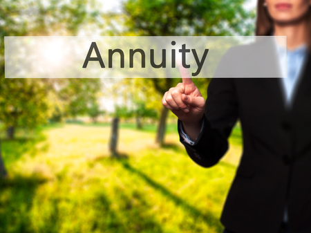 variable rate: Annuity - Isolated female hand touching or pointing to button. Business and future technology concept. Stock Photo