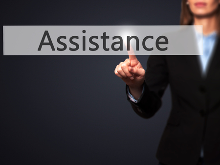 personal data assistant: Assistance - Isolated female hand touching or pointing to button. Business and future technology concept. Stock Photo
