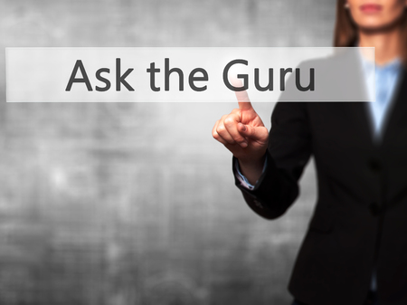 stock market launch: Ask the Guru - Isolated female hand touching or pointing to button. Business and future technology concept. Stock Photo