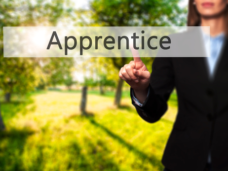Apprentice - Isolated female hand touching or pointing to button. Business and future technology concept. Stock Photo