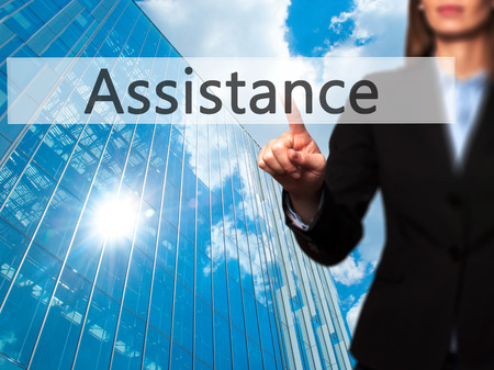 Assistance - Isolated female hand touching or pointing to button. Business and future technology concept. Stock Photo