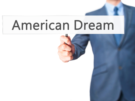 ethos: American Dream - Businessman hand holding sign. Business, technology, internet concept. Stock Photo